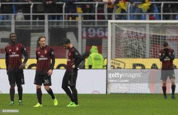 Cristian Zapata Ignazio Abate and Fernandez Suso of AC Milan look dejected at the end of the Serie A match between AC Milan and UC Sampdoria at...