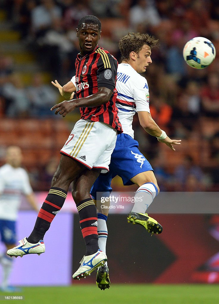 Cristian Zapata of AC Milan (L) and Manolo Gabbiadini of UC Sampdoria compete for the ball during the Serie A match between AC Milan and UC Sampdoria at Stadio Giuseppe Meazza on September 28, 2013 in Milan, Italy.