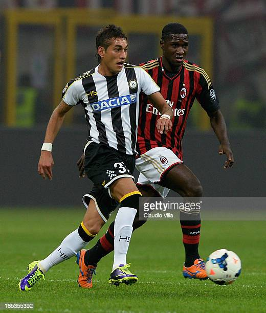 Cristian Zapata of AC Milan and Roberto Pereyra of Udinese Calcio compete for the ball during the Serie A match between AC Milan and Udinese Calcio...