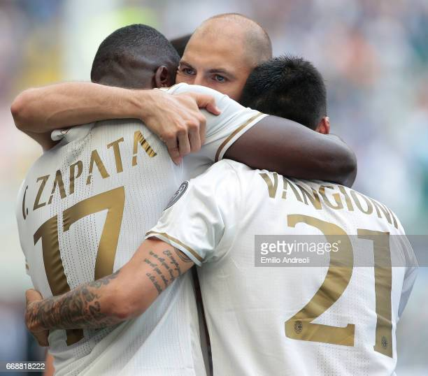 Cristian Zapata of AC Milan celebrates his goal with team mate Gabriel Paletta and Leonel Vangioni during the Serie A match between FC Internazionale...