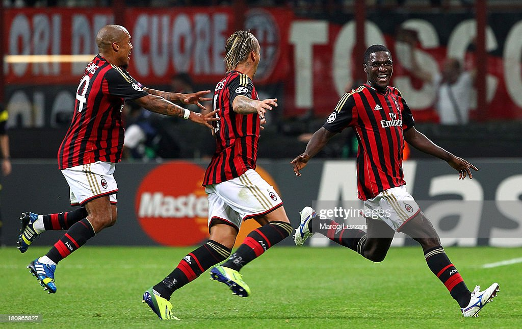 Cristian Zapata of AC Milan celebrates with his teammates Philippe Mexes and Nigel De Jong after scoring the opening goal during the UEFA Champions...