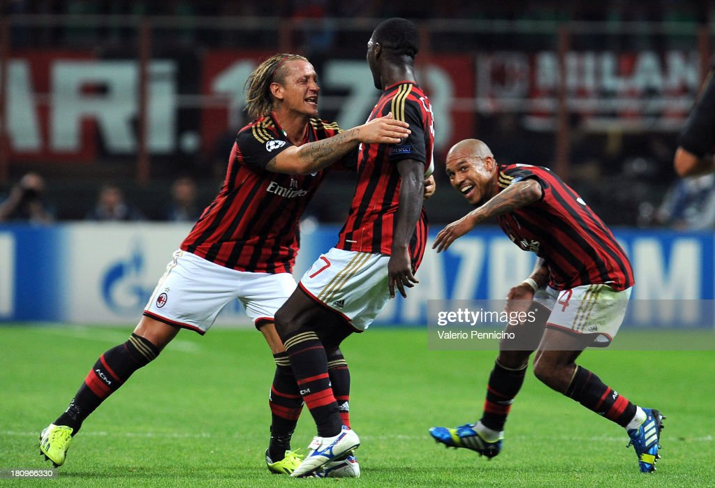 Cristian Zapata (C) of AC Milan celebrates with team-mates Philippe Mexes (L) and Nigel de Jong after scoring the opening goal during the UEFA Champions League group H match between AC Milan and Celtic at Stadio Giuseppe Meazza on September 18, 2013 in Milan, Italy.