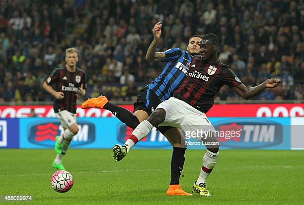 Cristian Zapata of AC Milan competes for the ball with Mauro Emanuel Icardi of FC Internazionale Milano during the Serie A match between FC...