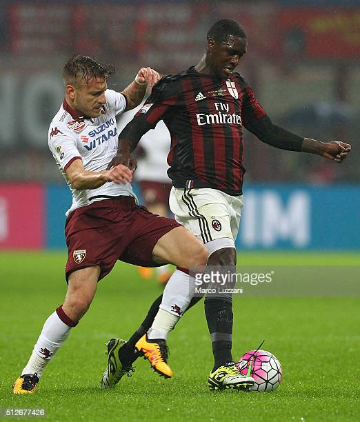 Cristian Zapata of AC Milan is challenged by Ciro Immobile of Torino FC during the Serie A match between AC Milan and Torino FC at Stadio Giuseppe...