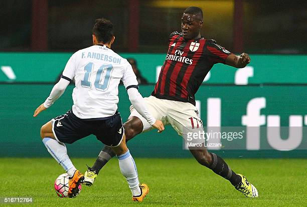 Cristian Zapata of AC Milan is challenged by Felipe Anderson of SS Lazio during the Serie A match between AC Milan and SS Lazio at Stadio Giuseppe...