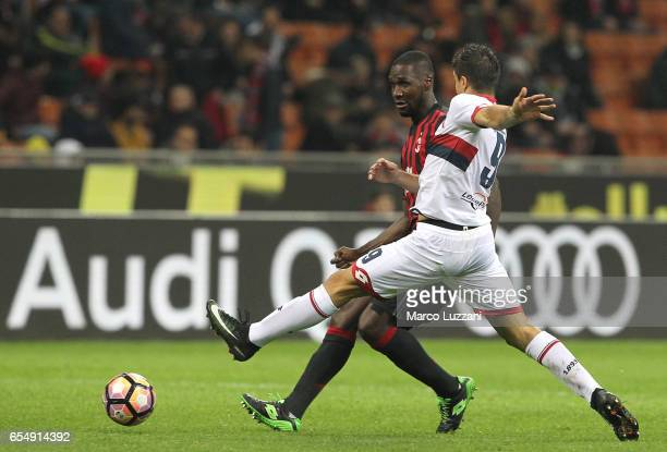 Cristian Zapata of AC Milan is challenged by Giovanni Simeone of Genoa CFC during the Serie A match between AC Milan and Genoa CFC at Stadio Giuseppe...