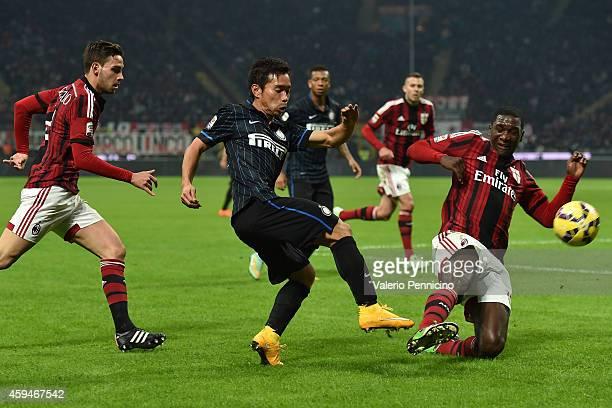 Cristian Zapata of AC Milan tackles Yuto Nagatomo of FC Internazionale Milano during the Serie A match between AC Milan and FC Internazionale Milano...