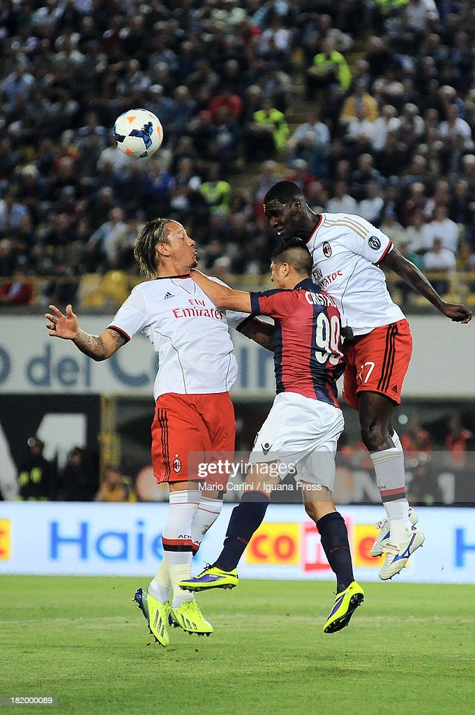 <a gi-track='captionPersonalityLinkClicked' href=/galleries/search?phrase=Cristian+Zapata&family=editorial&specificpeople=854055 ng-click='$event.stopPropagation()'>Cristian Zapata</a> # 17 of AC Milan ( R ) wins a header over Cristaldo # 99 of Bologna FC ( C ) as his teamate Phillppe Mexes # 5 of AC Milan ( L ) looks on during the Serie A match between Bologna and AC Milan at Stadio Renato Dall'Ara on September 25, 2013 in Bologna, Italy.