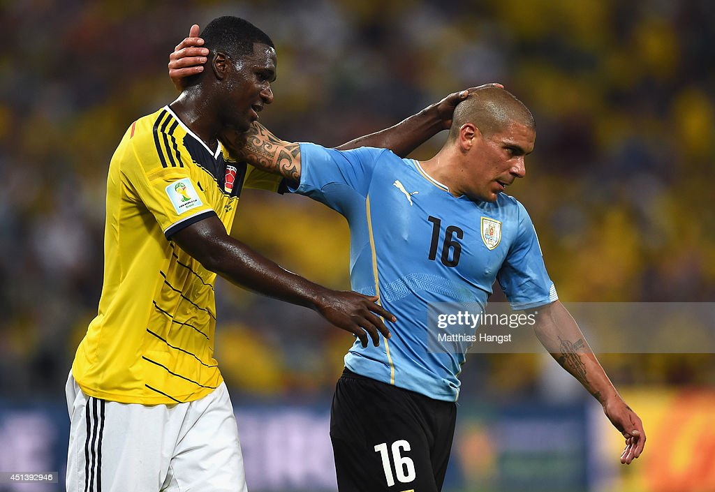 <a gi-track='captionPersonalityLinkClicked' href=/galleries/search?phrase=Cristian+Zapata&family=editorial&specificpeople=854055 ng-click='$event.stopPropagation()'>Cristian Zapata</a> of Colombia and Maximilliano Pereira of Uruguay react during the 2014 FIFA World Cup Brazil round of 16 match between Colombia and Uruguay at Maracana on June 28, 2014 in Rio de Janeiro, Brazil.