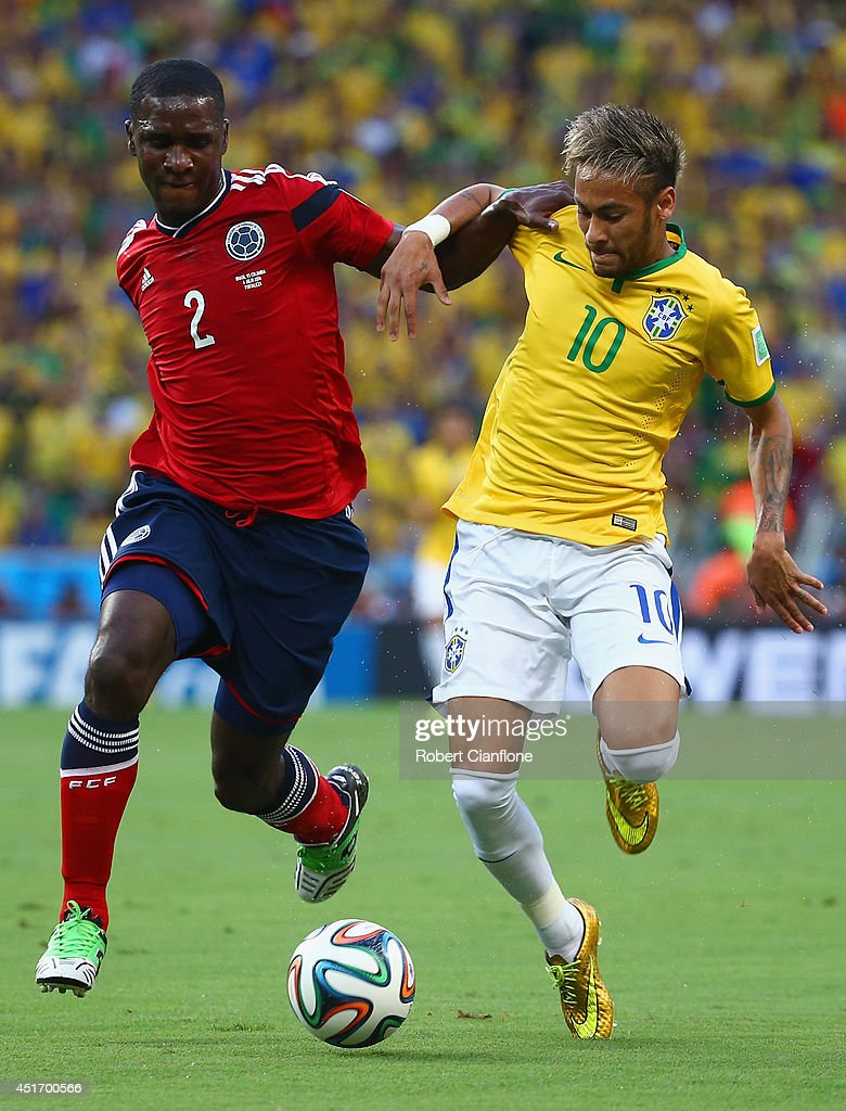 <a gi-track='captionPersonalityLinkClicked' href=/galleries/search?phrase=Cristian+Zapata&family=editorial&specificpeople=854055 ng-click='$event.stopPropagation()'>Cristian Zapata</a> of Colombia and Neymar of Brazil compete for the ball during the 2014 FIFA World Cup Brazil Quarter Final match between Brazil and Colombia at Castelao on July 4, 2014 in Fortaleza, Brazil.