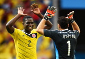 Cristian Zapata of Colombia celebrates with goalkeeper David Ospina after defeating the Ivory Coast 21 during the 2014 FIFA World Cup Brazil Group C...