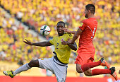 Cristian Zapata of Colombia jumps for the ball with Carlos Zambrano of Peru during a match between Colombia and Peru as part of FIFA 2018 World Cup...