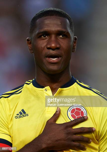 Cristian Zapata of Colombia stands for their national athem prior to the international friendly match between Spain and Colombia at Nueva Condomina...
