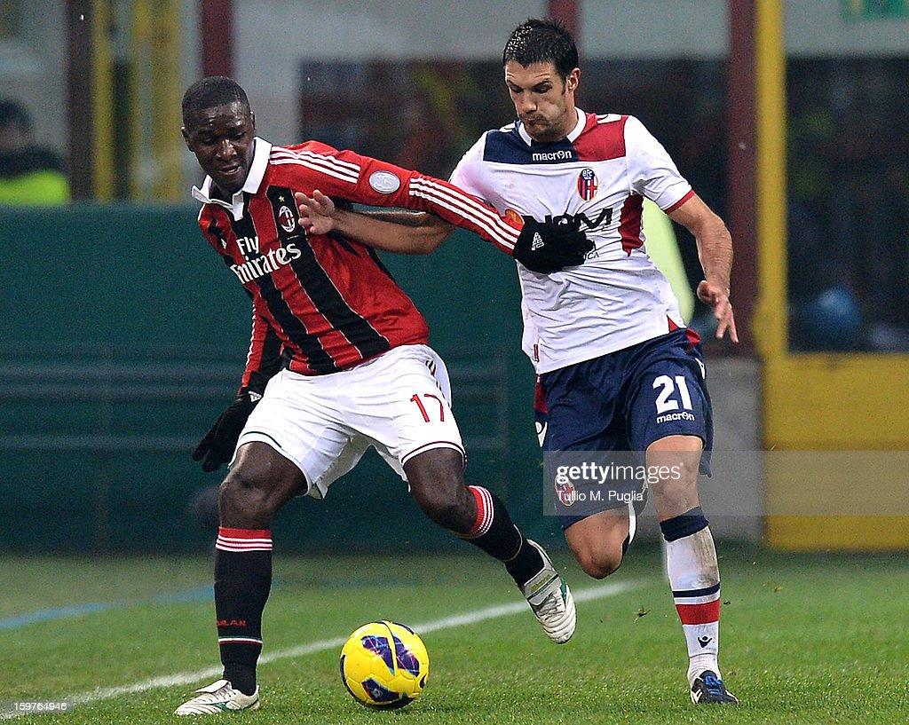 Cristian Zapata (L) of Milan and Nicolo Cherubin (R) of Bologna compete for the ball during the Serie A match between AC Milan and Bologna FC at San Siro Stadium on January 20, 2013 in Milan, Italy.