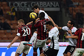 Cristian Zapata of Milan scores an own goal during the Serie A match between AC Milan and US Citta di Palermo at Stadio Giuseppe Meazza on November 2...