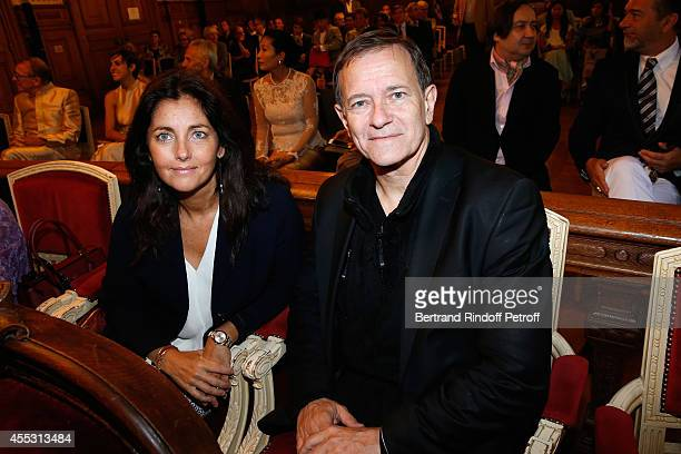 Cristiana Reali and Francis Huster attend the Wedding of Francois Florent And Kanee Danevong at Mairie Du XVIII on September 12 2014 in Paris France