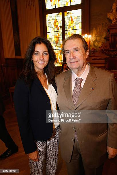 Cristiana Reali and Francois Florent attend the Wedding of Francois Florent And Kanee Danevong at Mairie Du XVIII on September 12 2014 in Paris France