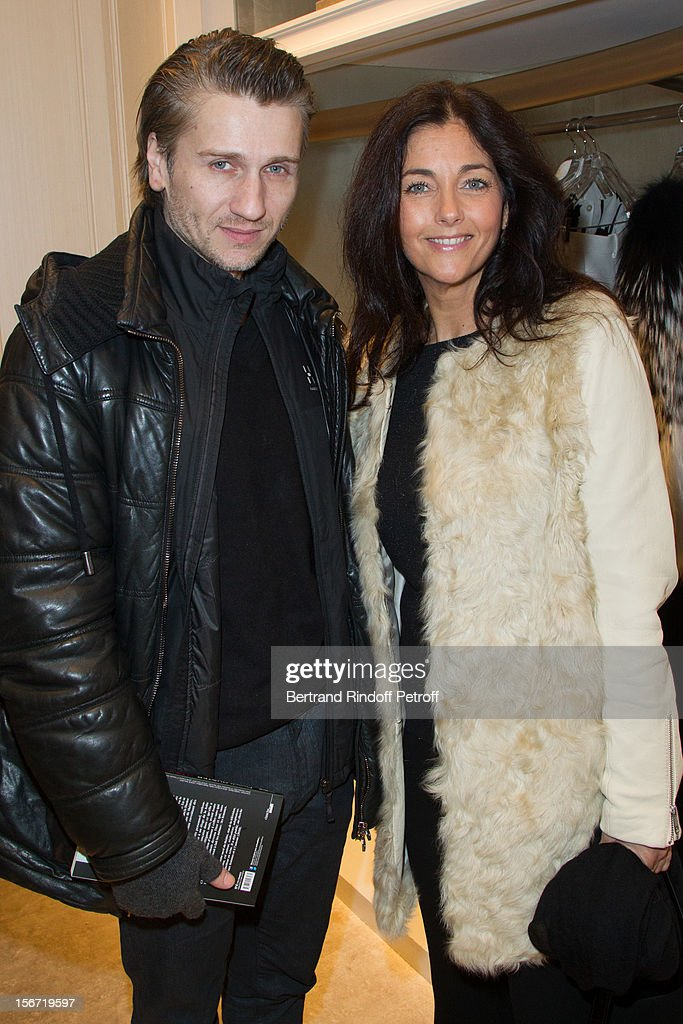 Cristiana Reali (R) and Stanislas Merhar attend the signing of Francis Huster's book 'And Dior Created Woman' at Dior Boutique on November 19, 2012 in Paris, France.