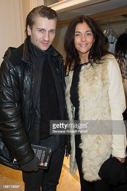 Cristiana Reali and Stanislas Merhar attend the signing of Francis Huster's book 'And Dior Created Woman' at Dior Boutique on November 19 2012 in...