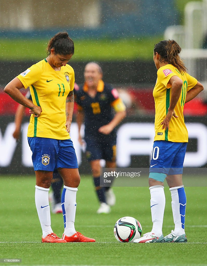 <a gi-track='captionPersonalityLinkClicked' href=/galleries/search?phrase=Cristiane+-+Soccer+Player&family=editorial&specificpeople=14663038 ng-click='$event.stopPropagation()'>Cristiane</a> (11) and <a gi-track='captionPersonalityLinkClicked' href=/galleries/search?phrase=Marta+-+Soccer+Player&family=editorial&specificpeople=3038337 ng-click='$event.stopPropagation()'>Marta</a> of Brazil look dejected as Kyah Simon of Australia scores their first goal during the FIFA Women's World Cup 2015 round of 16 match between Brazil and Australia at Moncton Stadium on June 21, 2015 in Moncton, Canada.