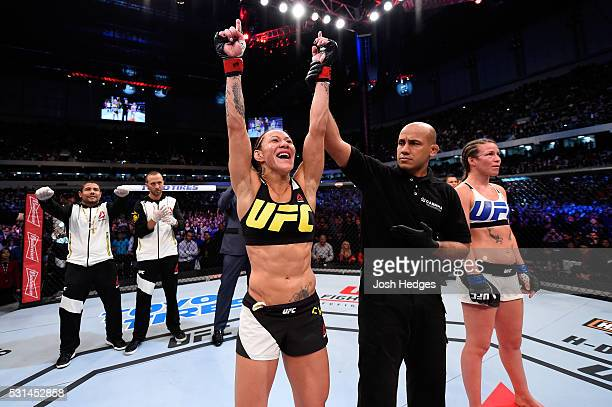 Cristiane 'Cyborg' Justino of Brazil celebrates after defeating Leslie Smith in their women's catchweight bout during the UFC 198 event at Arena da...