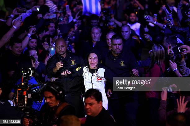 Cristiane 'Cyborg' Justino of Brazil enters the arena before facing Leslie Smith in their women's catchweight bout during the UFC 198 event at Arena...