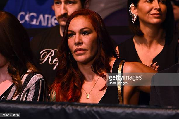 Cristiane 'Cyborg' Justino sits Octagonside during the UFC Fight Night event at the US Airways Center on December 13 2014 in Phoenix Arizona