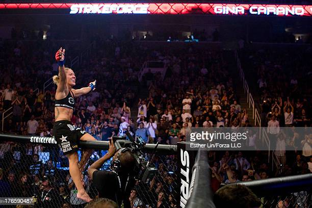 Cristiane 'Cyborg' Santos celebrates with the crowd after her victory over Gina Carano during the inaugural Strikeforce Women's Championship event at...