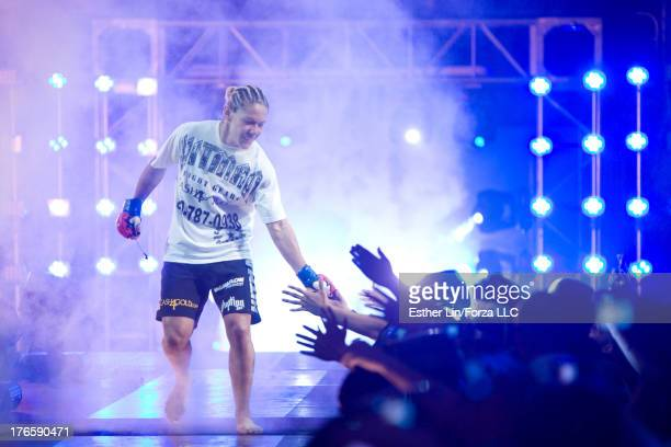 Cristiane 'Cyborg' Santos is introduced prior to her bout against Gina Carano during the inaugural Strikeforce Women's Championship event at HP...