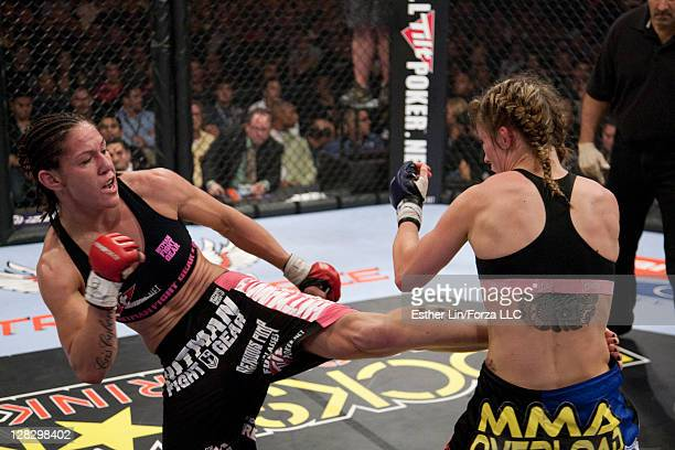 Cristiane 'Cyborg' Santos kicks Marloes Coenen during the Women's Featherweight Championship bout at the Strikeforce Miami event on January 30 2010...