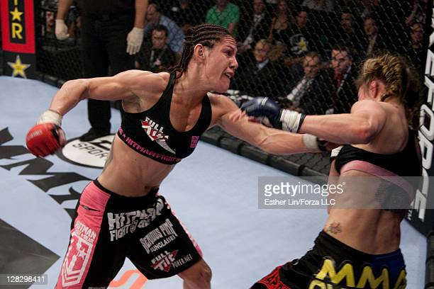 Cristiane 'Cyborg' Santos punches Marloes Coenen during the Women's Featherweight Championship bout at the Strikeforce Miami event on January 30 2010...