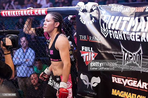 Cristiane 'Cyborg' Santos stands in the cage before the Women's Featherweight Championship bout against Marloes Coenen at the Strikeforce Miami event...