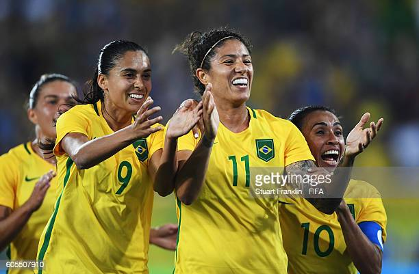 Cristiane of Brazil celebrates scoring her goal with Marta and Andressa Alves during the Olympic Women's Football match between Brazil and Sweden at...