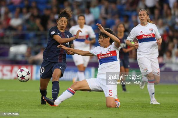 Cristiane of PSG is tackled by Saki Kumagai of Olympique Lyonnais during the UEFA Women's Champions League Final between Lyon and Paris Saint Germain...