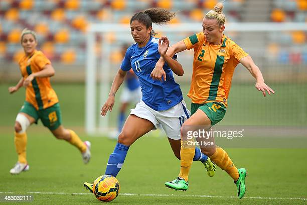 Cristiane Rozeira of Brazil and Teigan Allen of Australia compete for the ball during the Women's International Friendly match between the Australian...