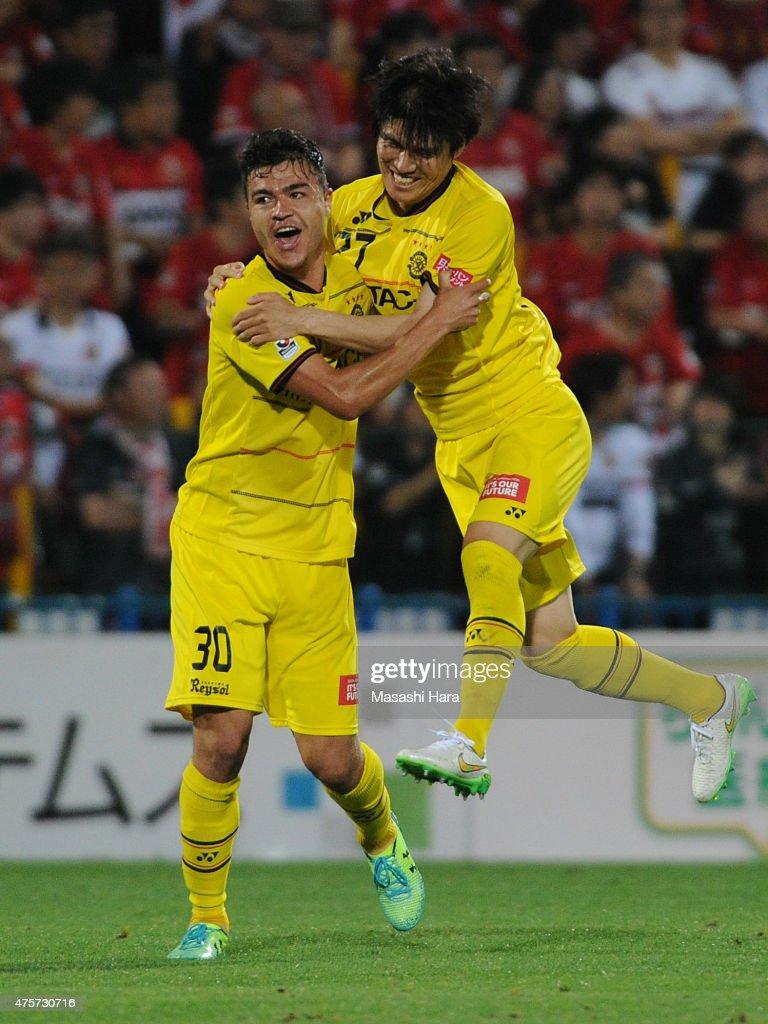 Cristiano (L) and Kim Chang Soo of Kashiwa Reysol celebrate their second goal during the J.League match between Kashiwa Reysol and Urawa Red Diamonds at Hitachi Kashiwa Soccer Stadium on June 3, 2015 in Kashiwa, Chiba, Japan.