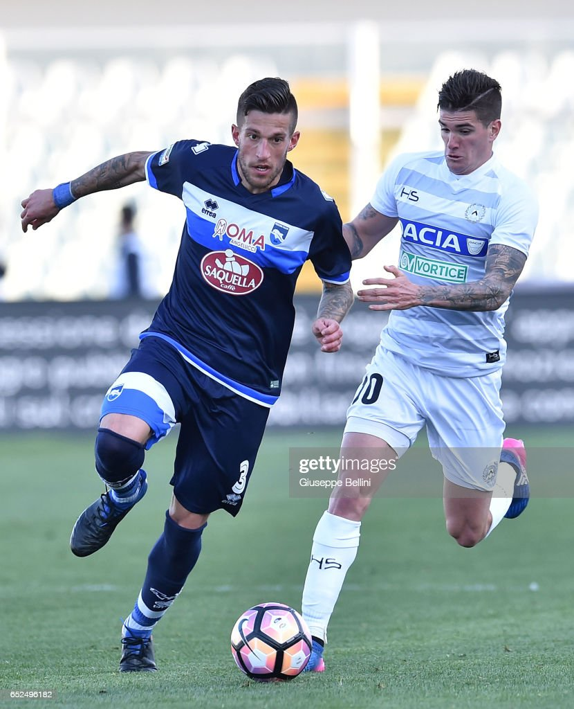 Cristiano Biraghi of Pescara Calcio and Rodrigo De Paul of Udinese Calcio in action during the Serie A match between Pescara Calcio and Udinese Calcio at Adriatico Stadium on March 12, 2017 in Pescara, Italy.