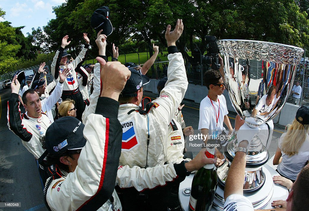 Cristiano da Matta (far back left) celebrates with his Newman-Haas Racing crew members , after winning the race and the CART Championship at the Grand Prix Americas, round 16 of the CART (Championship Auto Racing Teams) Fed Ex Championship Series on October 6, 2002 in Miami, Florida. (Photo by Robert Laberge/Getty Images).