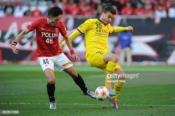 Cristiano Da Silva of Kashiwa Reysol and Ryota Moriwaki of Urawa Red Diamonds compete for the ball the 95th Emperor's Cup semi final match between...