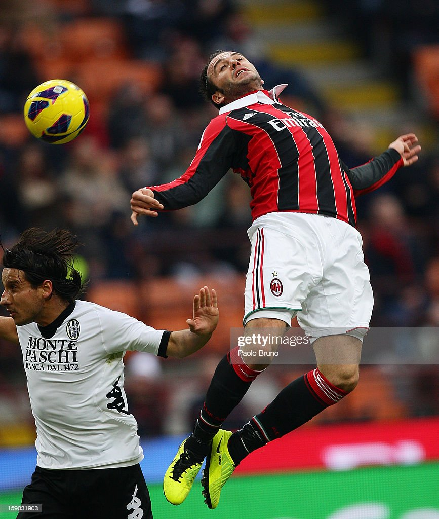 Cristiano Del Grosso (L) of AC Siena competes for the ball with Gianpaolo Pazzini of AC Milan during the Serie A match between AC Milan and AC Siena at San Siro Stadium on January 6, 2013 in Milan, Italy.