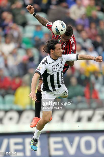 Cristiano Del Grosso of AC Siena fights for the ball with Kevin Prince Boateng of AC Milan during the Serie A match between AC Siena and AC Milan at...