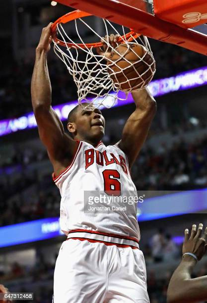 Cristiano Felicio of the Chicago Bulls dunks against the Golden State Warriors at the United Center on March 2 2017 in Chicago Illinois The Bulls...