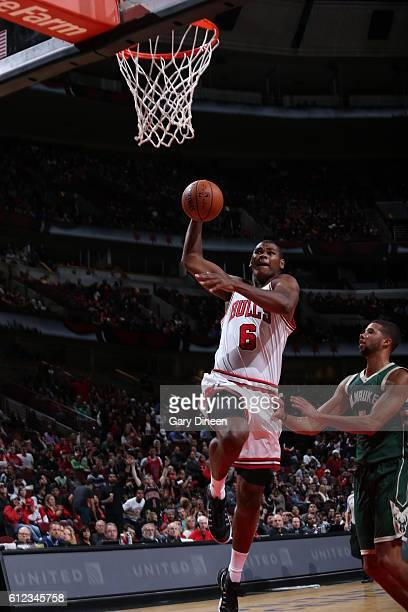 Cristiano Felicio of the Chicago Bulls goes for a lay up against the Milwaukee Bucks during a preseason game on October 3 2016 at United Center in...