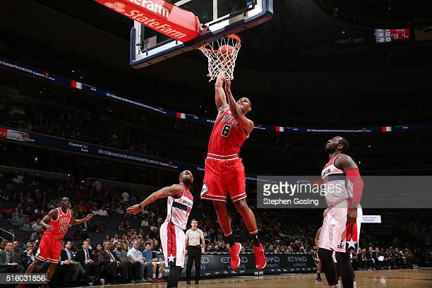 Cristiano Felicio of the Chicago Bulls goes for the dunk against the Washington Wizards during the game on March 16 2016 at Verizon Center in...