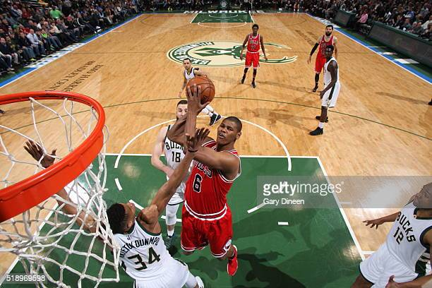 Cristiano Felicio of the Chicago Bulls goes to the basket against Giannis Antetokounmpo of the Milwaukee Bucks on April 3 2016 at the BMO Harris...