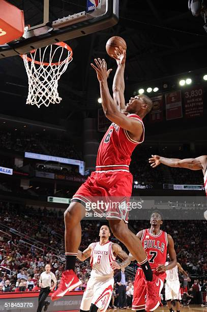 Cristiano Felicio of the Chicago Bulls goes to the basket against the Houston Rockets on March 31 2016 at the Toyota Center in Houston Texas NOTE TO...