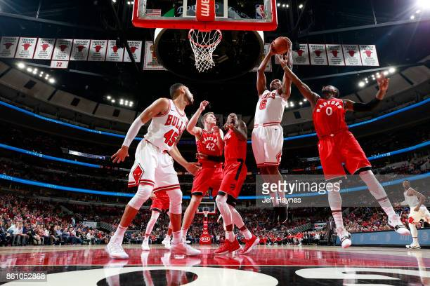 Cristiano Felicio of the Chicago Bulls goes to the basket against the Toronto Raptors on October 13 2017 at the United Center in Chicago Illinois...