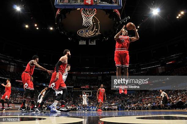 Cristiano Felicio of the Chicago Bulls grabs the rebound against the Orlando Magic on March 26 2016 at Amway Center in Orlando Florida NOTE TO USER...