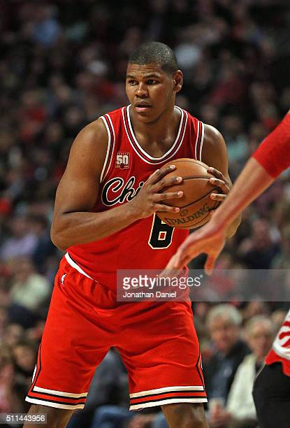 Cristiano Felicio of the Chicago Bulls looks to pass against the Toronto Raptors at the United Center on February 19 2016 in Chicago Illinois The...