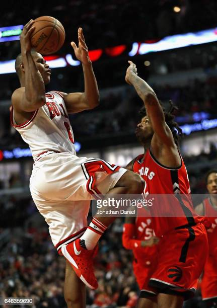 Cristiano Felicio of the Chicago Bulls puts up a shot against Lucas Nogueira of the Toronto Raptors at the United Center on February 14 2017 in...
